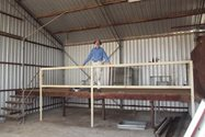 Ian Fletcher and the new guard rail in the Shearing Shed (Photo: Ian Fletcher).<br/>