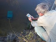 Testing salinity of the pools close to a fish trap. Photo Maureen Francesconi.<br/>
