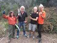 Volunteers Helen Tait, Tom Sjolund, Peter Eastman and Kim Eastman taking a break from removing gorse at South Esk Pine Reserve.<br/>