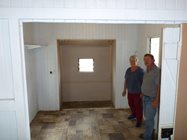 Volunteers Stuart and Sue Jones inspect the visitor's quarters before the new kitchen arrives.<br/>