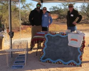 Kane Watson (Rangelands NRM), Jessica Stingemore (NACC) & Richard McLellan (NACC) setting up their stall<br/>