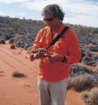 Murray Haseler with a centralian blue-tongue. Photo Matt Dell.