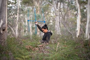 Riana Gardiner with a radio tracker, tracking collared bettongs in the Tasmanian Midlands. Photo by César Peñaherrera