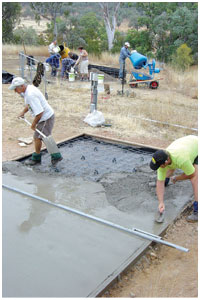 Concreting the garden shed floor. Photo Darren Larcombe.