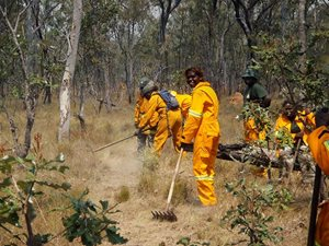 Warddeken Ranger Delvina Guymala and colleagues prepare to implement a back-burn. Photo Peter Cooke.