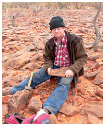 Dr John Long looks for fish fossils. Photo Courtesy Museum Victoria.