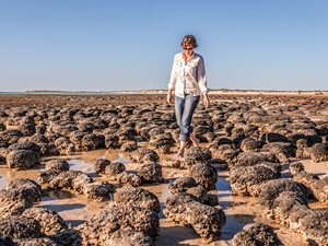 Dr Erica Suosaari walking among stromatolites at Hamelin Pool, WA. Photo by Annette Ruzicka.