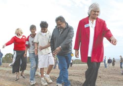 Noongar people at the Gondwana Link launch casting native seed to aid the revegetation. Photo Deborah Badger.