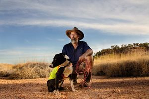 Mark Woods and trusty companion Maggie are helping in the fight to protect the Night Parrot from feral cat predation. Photo by Annette Ruzicka.