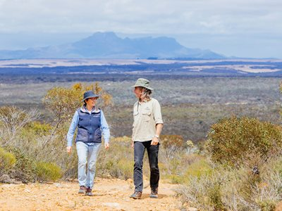 Bush Heritage ecologist Angela Sanders and Healthy Landscape Manager Simon Smale, with the Stirling Ranges in the background. Photo by William Marwick.