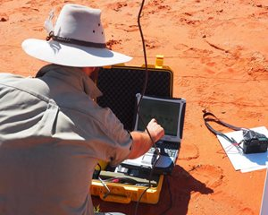 David Nelson (University of Sydney Research Assistant) downloads data from a weather station on Ethabaka. Photo Kate Cranney.