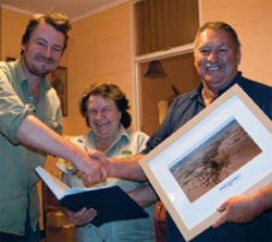 Glen Norris (left) presents Carolle and Paul Spencer with a photo of Bon Bon Station and a history of the area. Photo Craig Norris.