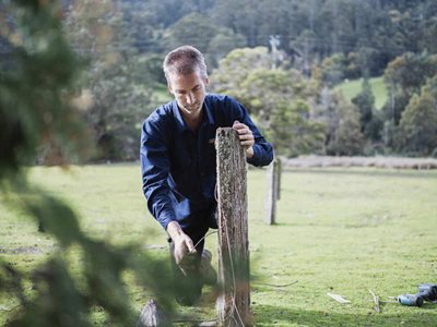 Reserve Manager Michael Bretz fixing a fence. Photo Daniel Peek.
