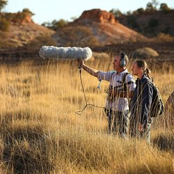 Dr Stephen Murphy and field assistant and partner Rachel Barr record reference calls among the spinifex at the undisclosed location of Night Parrot population. Photo from The Australian.