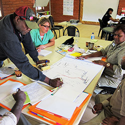 Emma Ignjic (second from left) coaching Healthy Country Planning at a workshop in Coen, Cape York. Photograph by Ellie Austin