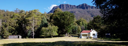 Photo of Oura cottage with Dry's Bluff in the background