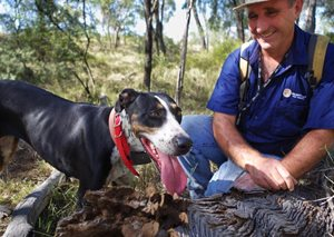 Bush Heritage volunteer Shane Jackson and his Catahoula dog Annie. Photo Leanne Hales.