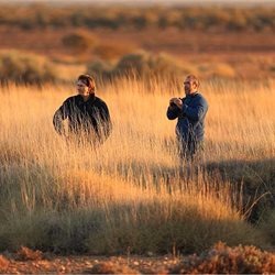 Dr Jim Radford and Dr Steve Murphy among spinifex