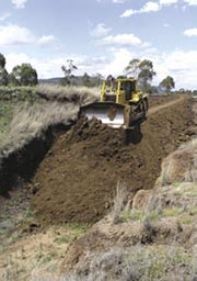 Soil from the dam wall is used to fill the gully. Photo Darren Larcombe and Glen Norris.